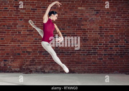 motivated active choreographer doing a stunt, full length photo. copy space - Stock Image