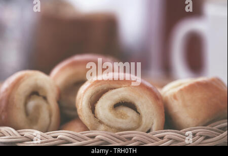 Rolled cinnamon bread a popular snacks taking with coffee - Stock Image