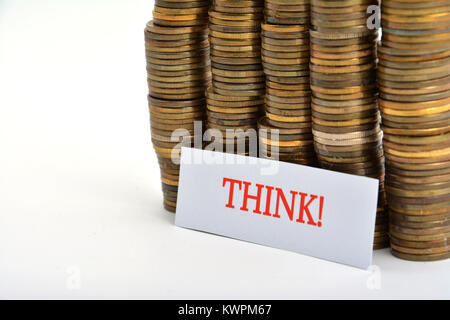 Word think with coins isolated on white background - Stock Image