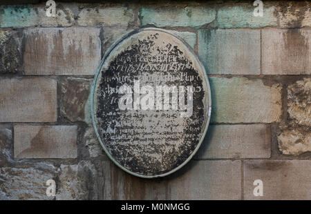 Plaque on the limestone wall of St George's Church, Stamford, Lincolnshire, England - Stock Image