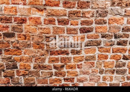 Red brick wall texture background; Old aged brick wall - Stock Image