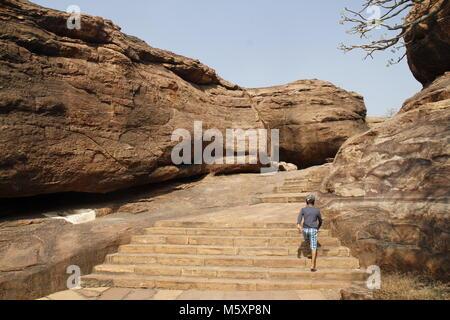 Young boy trekking the Badami caves, Karnataka, India - Stock Image