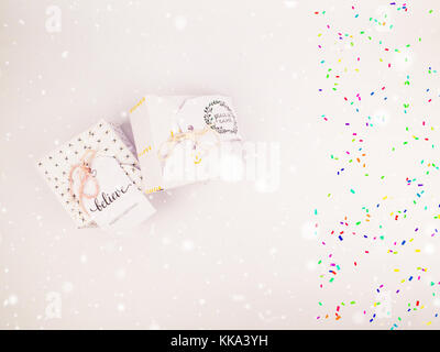 Christmas decoration with square gift box for celebration with confetti best Christmas holidays background image - Stock Image