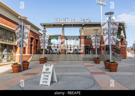 CHARLOTTE, NC, USA-1/8/19: South entrance to the BB&T Ballpark in Christmas season, home of the Charlotte Knights.  Christmas wreaths on gates. - Stock Image