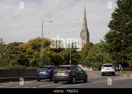 traffic entering Salisbury roundabout with cathedral spire in distance post Skripal tragedy - Stock Image