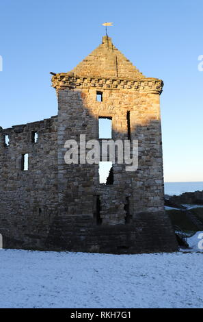 Ruin of St Andrews castle with snow Scotland  February 2019 - Stock Image