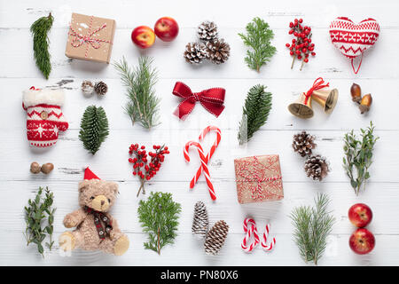 Christmas gifts, pine branches, apples and ribbon on wooden table.Top view,flat lay. - Stock Image