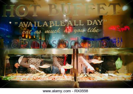 Chinese Restaurant exterior, looking thru window on a wet night. Wardour St., Chinatown area of London, UK. - Stock Image
