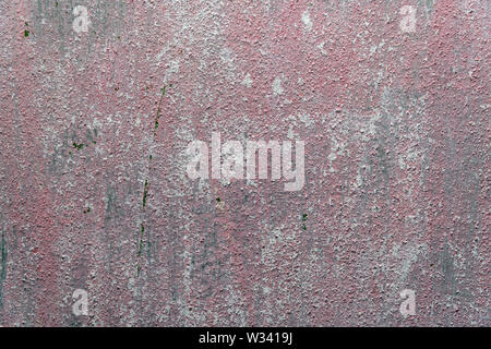Texture of old reddish grey cement wall - Stock Image