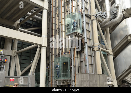 Lloyd's in and out building in London, with lifts on the outside of the building - Stock Image
