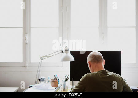Mature man working in creative studio - Stock Image