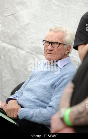 London, UK. 23rd Mar, 2019. Michael Heseltine, Baron and former Conservative Deputy Prime Minister, resting before speaking at the People's Vote March and rally, 'Put it to the People.' Credit: Prixpics/Alamy Live News - Stock Image