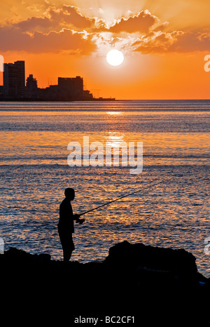 Fishing from the Malecon at sunset, Havana, Cuba - Stock Image