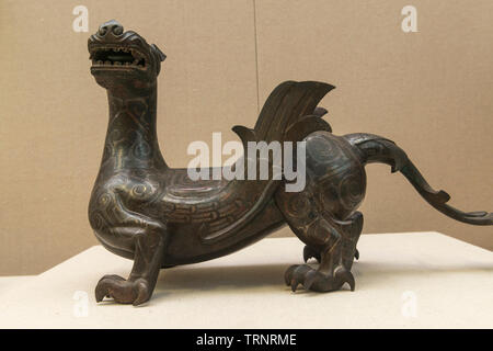 Bronze-inlaid-with-silver Mythical Animal. 475 BC-221 BC(The Warring States Period) Cultural Relics Institute Hebei Province, China - Stock Image