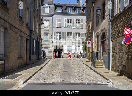 A coach party of tourists in the streets of Fougères, Britanny, France - Stock Image