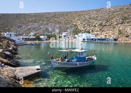 View over crystal clear water and fishing boats in harbour, Cheronissos, Sifnos, Cyclades, Aegean Sea, Greek Islands, Greece, Europe - Stock Image