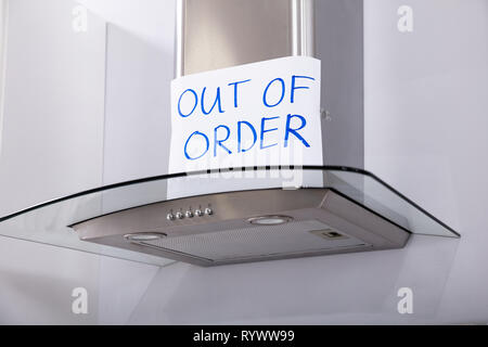 Written Text Out Of Order Message On Paper Over The Stuck Extractor Filter In Kitchen - Stock Image
