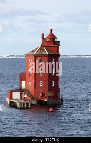 The Kjeungskjaer lighthouse, located on a small island at the mouth of the Bjungnfjorden in Norway. - Stock Image