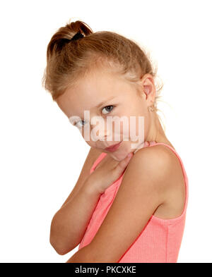 Six year old girl with slight smile - Stock Image