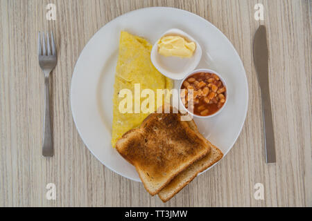A breakfast plate of omelette, toast and beans - Stock Image