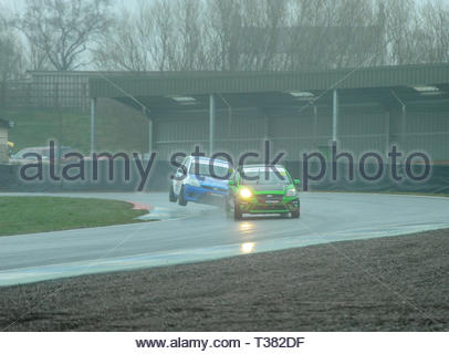 Dunfermline, UK. 7th April, 2019.  Jack Davidson lifts the offside cornering at McIntyreÕs during qualifying for a Scottish Fiesta/Mini Cooper S Cup  race at Knockhill Circuit. During a wet and misty start to the Scottish Championship Car Racing season organised by the SMRC (Scottish Motor Racing Club) at Knockhill. Credit: Roger Gaisford/Alamy Live News - Stock Image