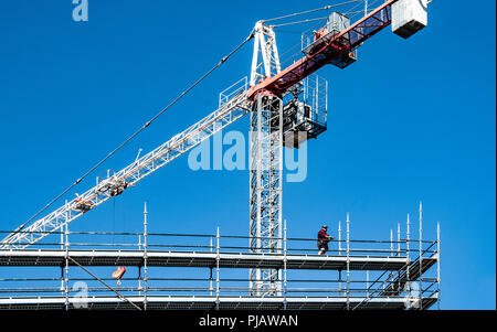 Gosford, New South Wales, Australia - August 4. 2018: Construction and building progress update 114.  A working tower crane on new home units building - Stock Image