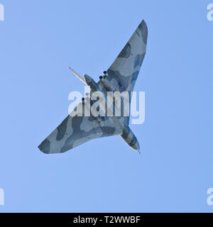 Avro Vulcan cold war era nuclear bomber in flight seen from below. - Stock Image