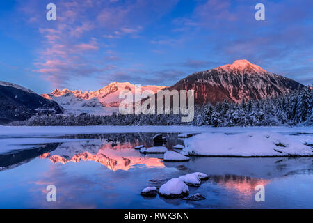 Winter afternoon sunset along the shoreline of Mendenhall River, Tongass National Forest; Alaska, United States of America - Stock Image