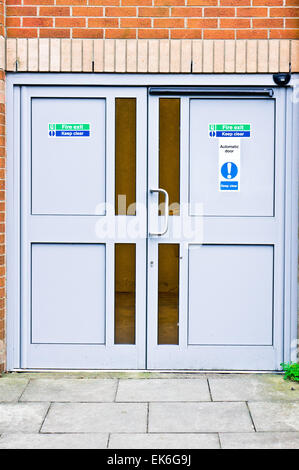 Double fire exit doors in a public building in the UK - Stock Image