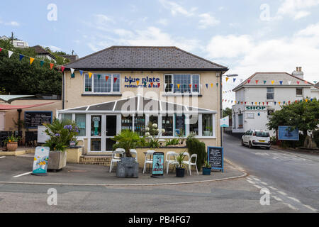 The Blue Plate restaurant on the corner of Main Road in Downderry, Cornwall, a small tourist village on the south coast - Stock Image