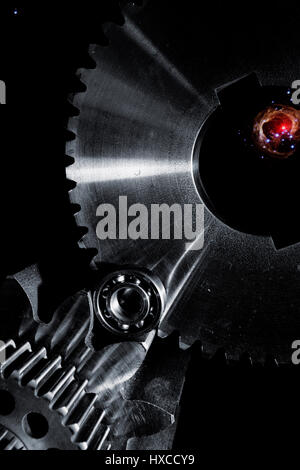 titanium gears and cogs in outer space, space technology - Stock Image