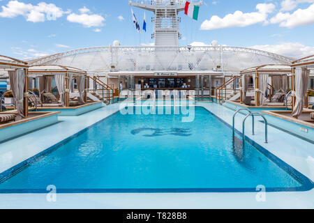 Civitavecchia, Italy - 20th September 2017: Swimming pool and the Retreat Bar on the Royal Princess cruise ship. Many ships dock here for Rome. - Stock Image