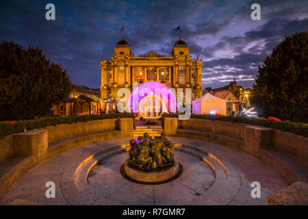 Zagreb Advent at night, Croatian National Theatre and The Well of Life is a sculpture by Ivan Mestrovic - Stock Image