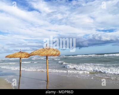 Two beach umbrellas - Stock Image
