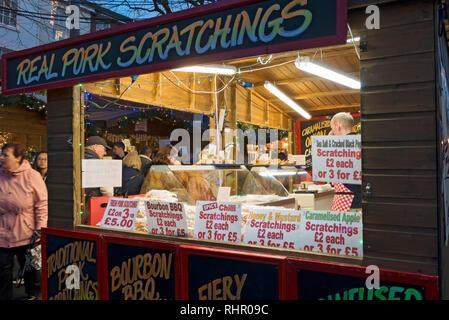 Trader selling pork products at St Nicholas Fayre York North Yorkshire England UK United Kingdom GB Great Britain - Stock Image