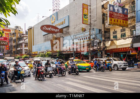Bangkok, Thailand - 7th March 2017: Traffic waiting at traffic lights on Yaowarat Road in Chinatown. The roads are always very busy. - Stock Image