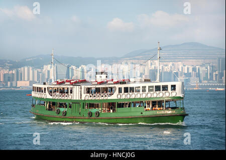 Hong Kong's Star Ferry crossing Victoria Harbour - Stock Image