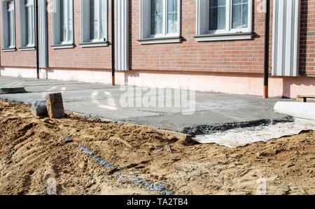concrete pavement near the new building on sunny summer day - Stock Image