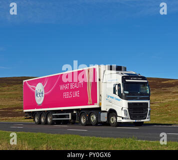 Great Bear Distribution HGV with Veet, 'What beauty feels like', trailer. M6 motorway Southbound carriageway, Shap, Cumbria, England, United Kingdom,. - Stock Image