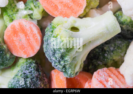 Picture of a bunch of frozen vegetables with focus on a piece of broccoli - Stock Image