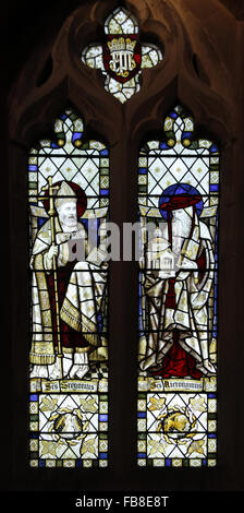 stained glass window  depicting saints Gregory and Hieronymus, St Peter's Church, Deene, Northamptonshire - Stock Image