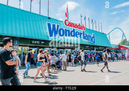 tourists at Canada's Wonderland amusement park entrance in Vaughan, ontario, canada - Stock Image