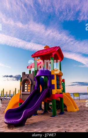 Playground, slide for children on the beach. Jesolo, Italy. - Stock Image