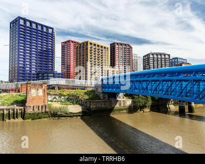 London, England, UK - June 1, 2019: Sun shines on new build high rise apartment buildings in the Leamouth housing development on Bow Creek river in Ca - Stock Image