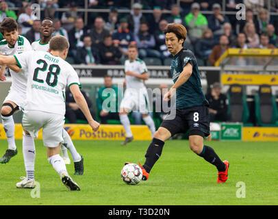 sports, football, Bundesliga, 2018/2019, Borussia Moenchengladbach vs SV Werder Bremen 1-1, Stadium Borussia Park, scene of the match, f.l.t.r. Tobias Strobl (MG), Denis Zakaria (MG), Matthias Ginter (MG), Yuya Osako (Bremen), DFL REGULATIONS PROHIBIT ANY USE OF PHOTOGRAPHS AS IMAGE SEQUENCES AND/OR QUASI-VIDEO - Stock Image