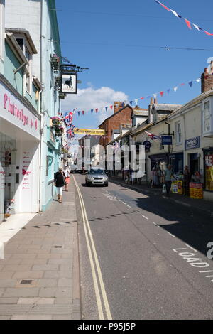 Shoppers visit Sidmouht High Street, East Devon, UK - Stock Image