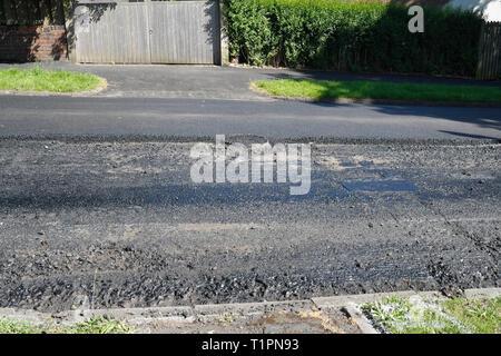 Road surface undergoing repair - Stock Image