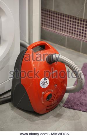 Red Bosch vacuum machine in a bathroom - Stock Image