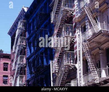 Apartment Buildings Replete with Fire escapes and 6 Storey Walk ups. The name SoHo refers to the area being South of Houston (Street), and was also a reference to the London district of Soho. It was coined by Chester Rapkin,  an urban planner and author of the  South Houston Industrial Area study, also known as the Rapkin Report. This began a naming convention that became a model for the names of emerging and re-purposed neighborhoods in New York such as Tribeca for Triangle Below Canal Street, DUMBO (Down Under the Manhattan Bridge Overpass), NoHo (North of Houston Street), Nolita (North of L - Stock Image