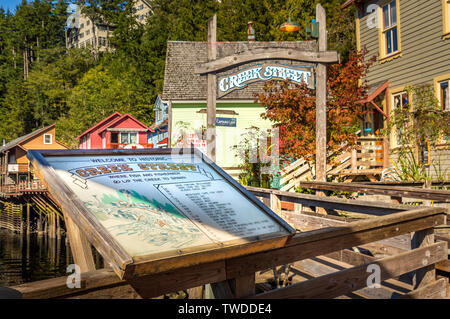 Sept. 17, 2018 - Ketchikan, AK: Information map and historic colorful wooden buildings of Creek St., built on a raised boardwalk above Ketchican Creek. - Stock Image